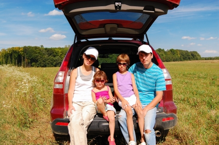 Family car trip on summer vacation, happy parents travel with kids and having fun  Car insurance concept photo