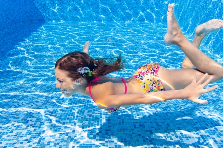 beautiful healthy girl swimming and having fun photo