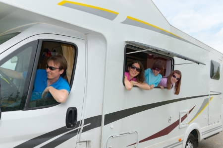 Family vacation, RV travel with kids, happy parents with children on holiday trip in motorhome photo