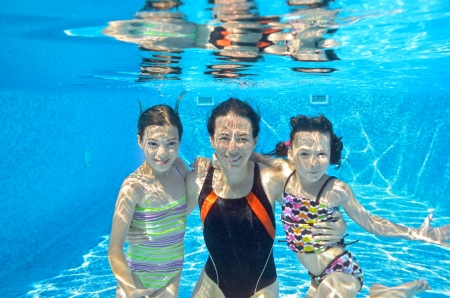 Happy family swim underwater in pool and having fun, mother and children on vacation Reklamní fotografie