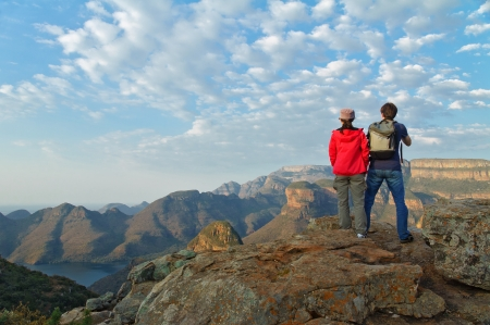 Happy couple looking at beautiful view of Blyde river canyon, travel in South Africa photo