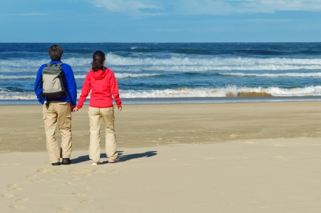 Happy couple on beautiful ocean beach, romantic vacation in South Africa photo