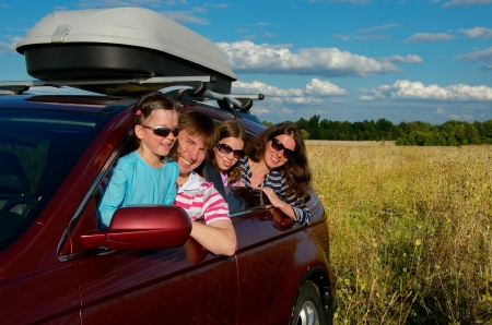 Family vacation, car trip on summer, happy parents travel with kids and having fun, car insurance concept Standard-Bild