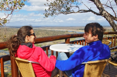 Happy couple looking at beautiful view of Kruger national park, travel  and safari in South Africa photo