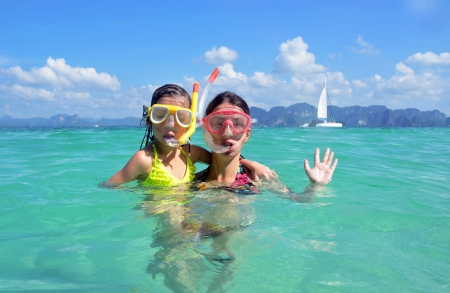 snorkeling: Happy mother and kid snorkeling in tropical sea, family beach vacation Stock Photo