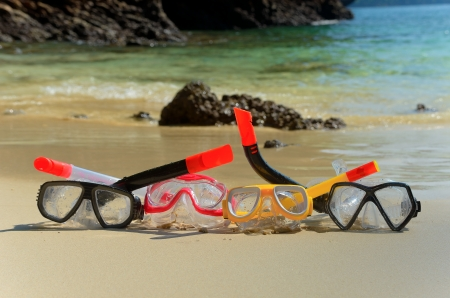 Snorkels on tropical beach sand photo