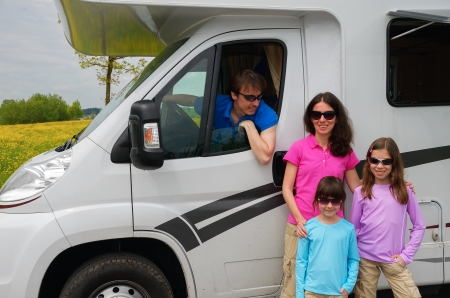 recreational vehicle: Family travel in motorhome  RV  on vacation, happy parents and kids having fun near camper