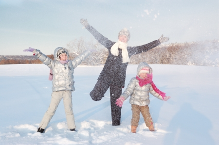 Happy family having fun and playing with snow outdoors photo