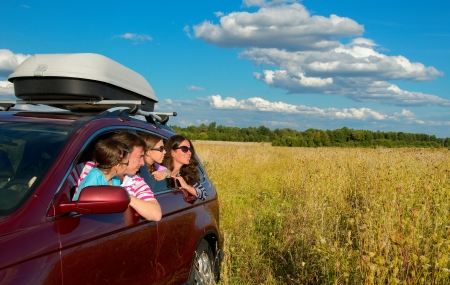Family in car on vacation, happy parents and kids travel and have fun, car insurance concept photo
