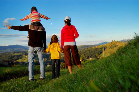 Happy family on vacation in mountains, hiking and looking and beautiful view Stock Photo