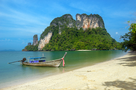 Longtail boat on beautiful tropical beach, Krabi, Thailand photo