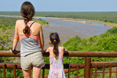 sabie sand: Mother and daughter looking at beautiful river view, tourists travel in South Africa, Kruger national park