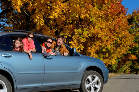cars road: Car trip on autumn family vacation, happy parents and kids travel and have fun, car insurance concept