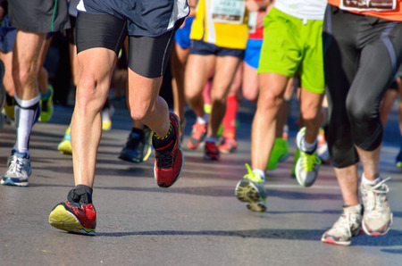 Marathon running race, people feet on road, sport, fitness and healthy lifestyle concept
