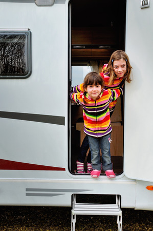 Kids in camper (rv), family travel in motorhome on vacation photo