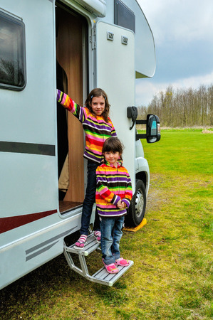 rv: Kids in camper (rv), family travel in motorhome on vacation