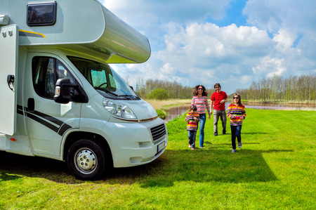 motorhome: Family vacation, RV (camper) travel with kids, happy parents with children on holiday trip in motorhome