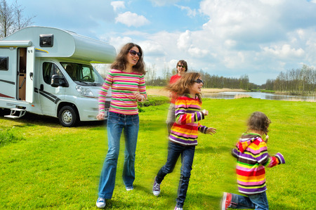 spring holiday: Family vacation, RV (camper) travel with kids, happy parents with children on holiday trip in motorhome