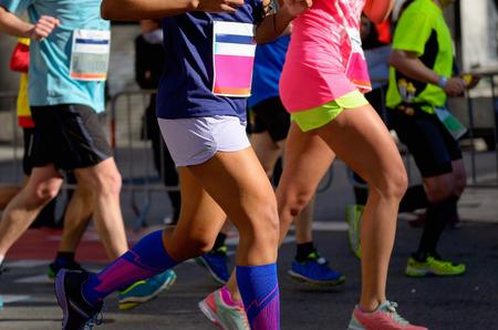 running race: Marathon running race, people feet on road, women run,  sport, fitness and healthy lifestyle concept