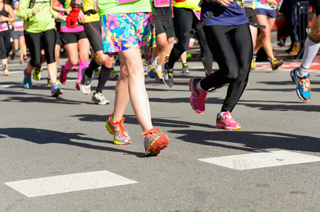 Marathon running race, people feet on road, woman run,  sport, fitness and healthy lifestyle concept