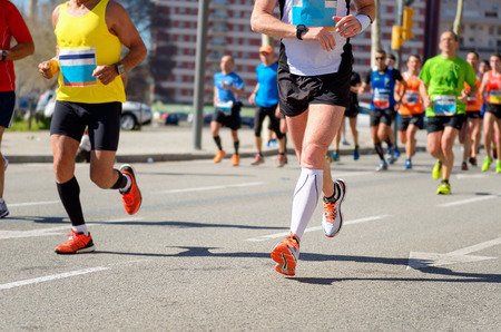 Marathon running race, runners feet on road, sport, fitness and healthy lifestyle concept Фото со стока