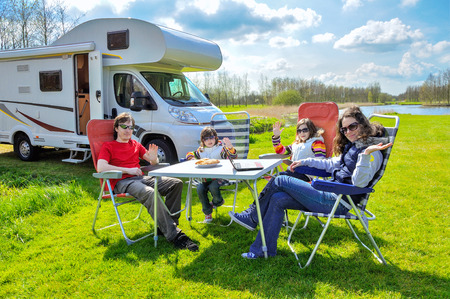 Family vacation RV camper travel with kids happy parents with children on holiday trip in motorhome