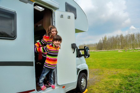 Kids in camper rv family travel in motorhome on vacation