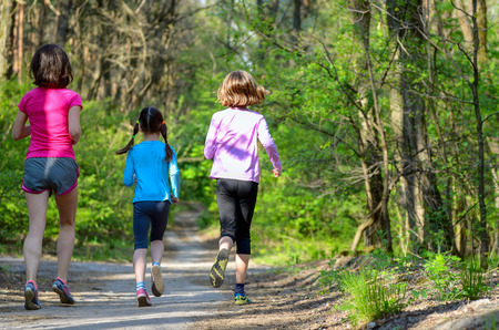 kids exercise: Family sport happy active mother and kids jogging outdoors running in forest