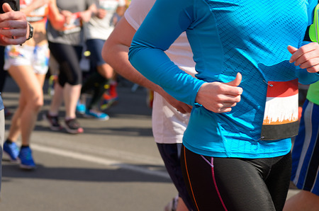 Marathon running race runners on road sport fitness and healthy lifestyle concept