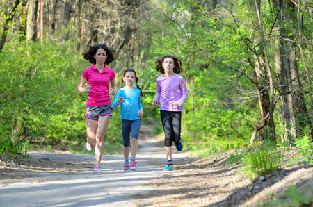 family exercise: Family sport happy active mother and kids jogging outdoors running in forest