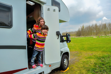 camper: Kids in camper rv, family travel in motorhome on vacation