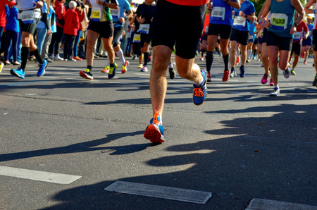 runners: Marathon running race, runners feet on road, sport, fitness and healthy lifestyle concept Stock Photo