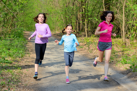 jog: Family sport, happy active mother and kids jogging outdoors, running in forest Stock Photo