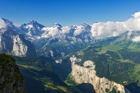 a meadow: Beautiful idyllic Alps landscape with mountains in summer, Switzerland