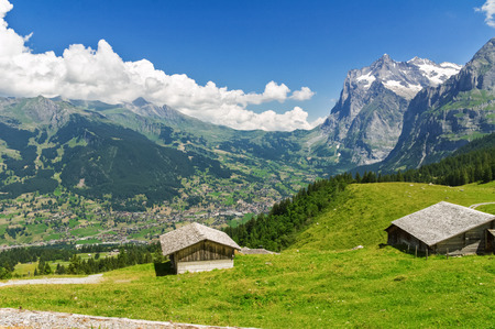 alp: Beautiful idyllic mountains landscape with country house (chalet) in summer, Alps, Switzerland Stock Photo