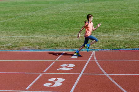child sport: Kids sport, child running on stadium track, training and fitness concept Stock Photo