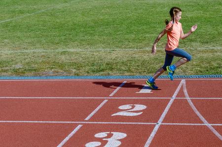 Kids Sport Child Running On Stadium Track Training And Fitness Concept Stock Photo
