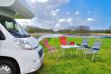 Family vacation, RV (camper) travel concept, motorhome trip, table and chairs in holiday campsite