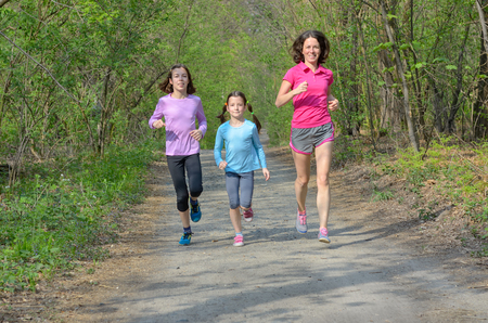 family exercise: Family fitness and sport, happy active mother and kids jogging outdoors, running in forest