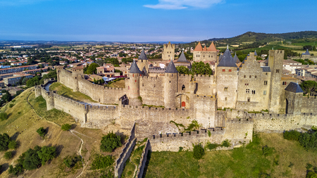 Aerial top view of Carcassonne medieval city and fortress castle from above, Sourthern France Imagens