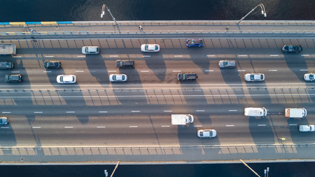 Aerial top view of bridge road automobile traffic of many cars, transportation concept Standard-Bild
