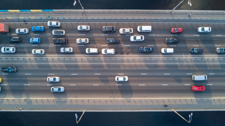 Aerial top view of bridge road automobile traffic of many cars, transportation concept Фото со стока