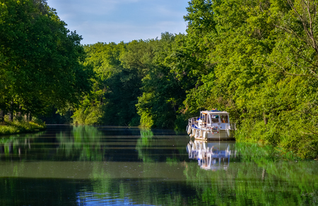 Boat on Canal du Midi, travel by barge and vacation in Southern France