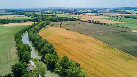 Aerial top view of Canal du Midi and vineyards from above, beautiful rural  countryside landscape of Southern France Stock Photo