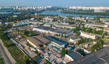 Aerial top view of industrial park zone from above, factory chimneys and warehouses, industry district in Kiev (Kyiv), Ukraine 報道画像