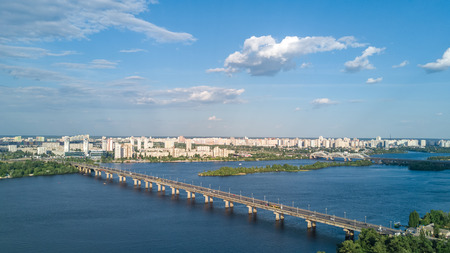 Aerial top view of Paton bridge and Dnieper river from above, city of Kiev, Ukraine