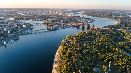 Aerial top view of Kyiv skyline, beautiful Dnieper river and Truchaniv island from above, sunset in Kiev city, Ukraine Reklamní fotografie