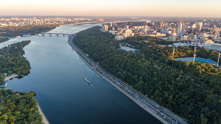 Aerial top view of sunset Kyiv skyline, Dnieper river and Truchaniv island from above, sunset in Kiev city, Ukraine