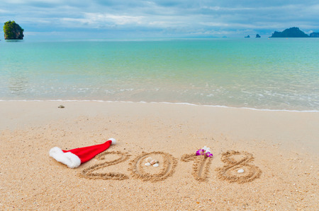 New year 2018 holiday vacation concept, 2018 written on tropical beach sand background Stock Photo