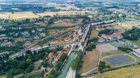Aerial top view of Fonserannes locks on canal du Midi from above, heritage landmark in France